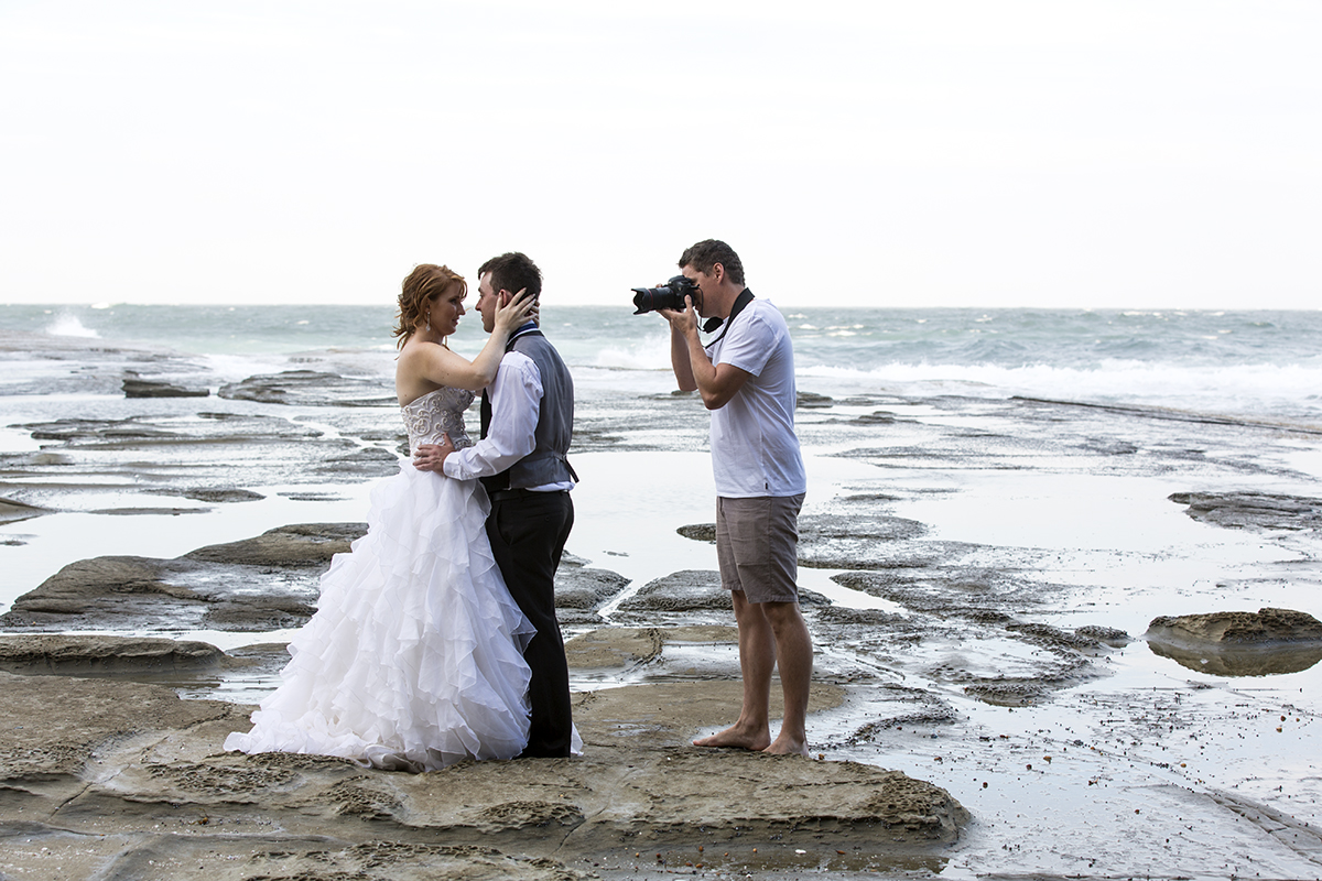 Gladstone wedding photographer shooting a bridal portrait in the beach