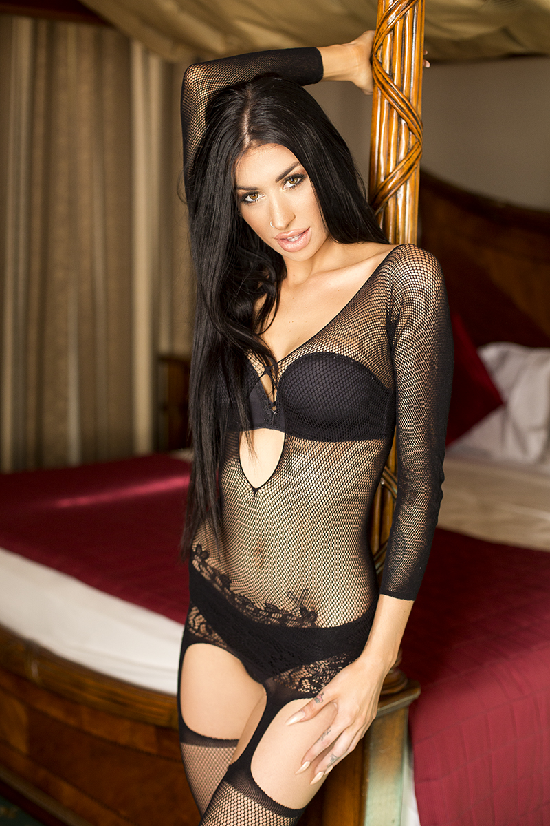 Girl standing during a boudoir shoot in black lace